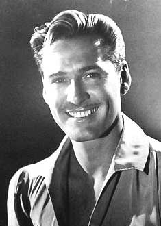 Errol Flynn, his part implied like a jungle path